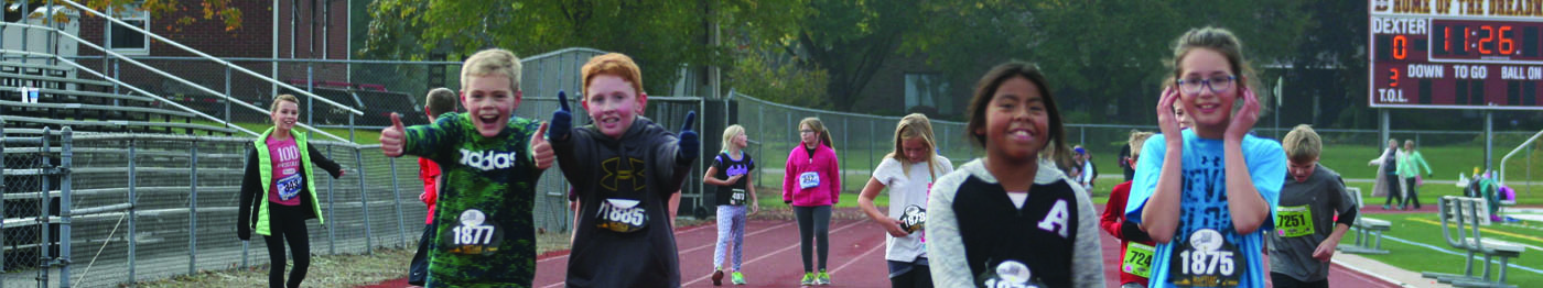 Creekside students run on the track at Al Ritt Field during Fun Run