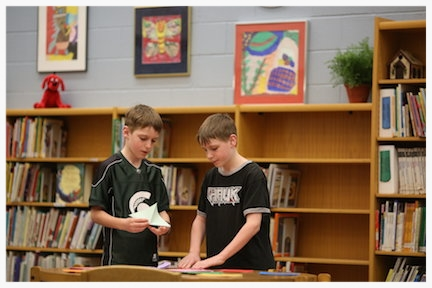 Two Creekside students working in the Media Center