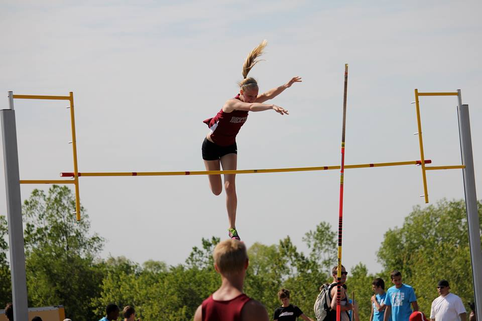 DHS Track and Field team performing in a pole vaulting competition