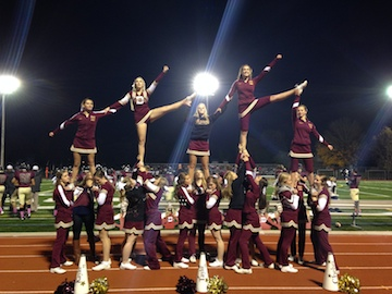 Dexter High School Cheer Team performing during a football game