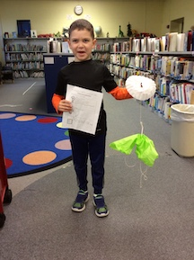 student making parachute with recycled materials